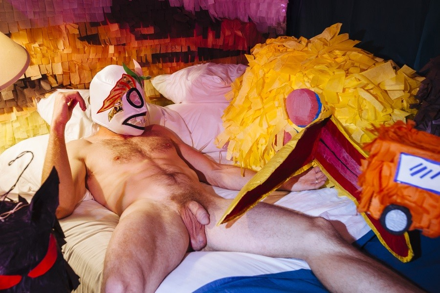 Colby Keller poses in a motel room with an installation by artist Justin Favela on March 29, 2015.